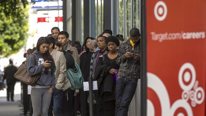 In this Thursday, Jan. 10, 2013, photo, hundreds of prospective candidates await their turn to apply for job openings at a Target job fair in Los Angeles. Target reports its quarterly earnings on Wednesday, May 22, 2013. (AP Photo/Damian Dovarganes)
