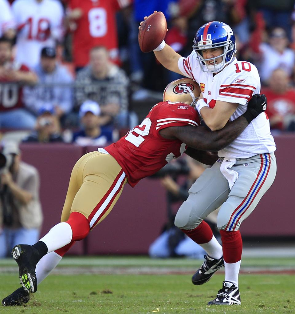 New York Giants quarterback Eli Manning (10) is sacked by San Francisco 49ers linebacker Patrick Willis (52) in the third quarter of an NFL football game in San Francisco, Sunday, Nov. 13, 2011. (AP Photo/Marcio Jose Sanchez)