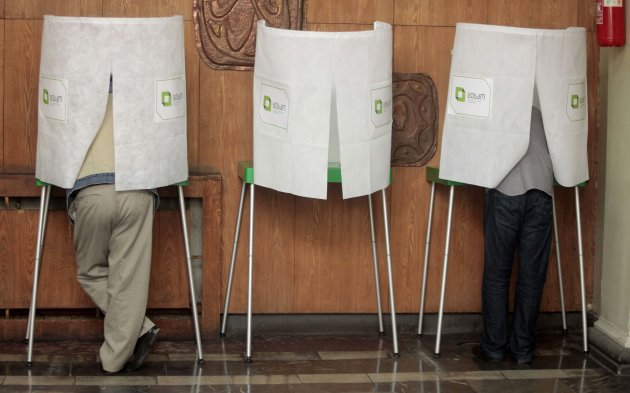 Georgians vote during the parliamentary election at a polling station in Tbilisi, Georgia, Monday, Oct. 1, 2012. Voters in Georgia are choosing a new parliament in a heated election Monday that will decide the future of Saakashvili's government. (AP Photo/Georgy Abdaladze)