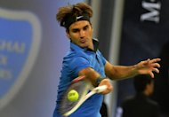 Roger Federer hits a return to Stanislas Wawrinka during their third round match at the Shanghai Masters tennis tournament, on October 11. Federer won 4-6, 7-6, 6-0