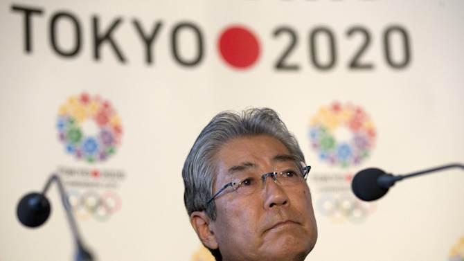 FILE - This is a Thursday, Jan. 10, 2013 file photo of Tsunekazu Takeda, President of the Tokyo 2020 Olympic games bid, as he listens to a question from the media during their first international presentation of the Tokyo 2020 Olympic Games bid in London.  The IOC's evaluation commission is heading to Japan this week on the first leg of its three-city tour to assess the bids from Tokyo, Madrid and Istanbul. Chaired by IOC Vice President Craig Reedie of Britain, the 14-member panel will meet with bid leaders and government officials and visit potential venues. (AP Photo/Alastair Grant, File)