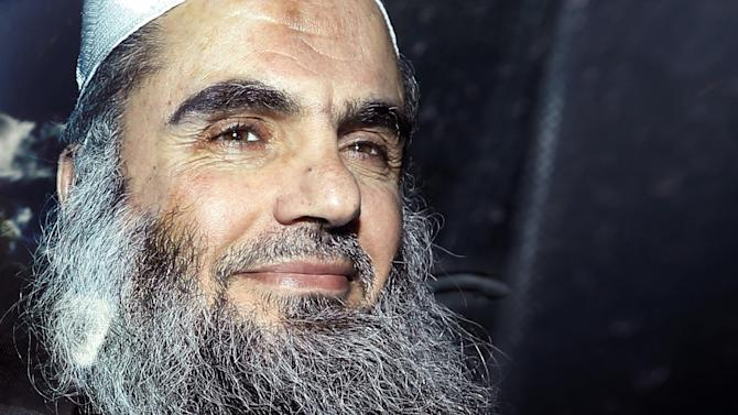 FILE - In this Tuesday, April 17, 2012 file photo, Abu Qatada is driven away after being refused bail at a hearing at London's Special Immigration Appeals Commission, which handles deportation and security cases, in London. Radical Preacher Abu Qatada  won his appeal against deportation from Britain to Jordan to face terrorism charges on Monday Nov. 12, 2012. The decision represents a setback to the British government. Home Office officials say they strongly disagree with the ruling. (AP Photo/Matt Dunham, File)