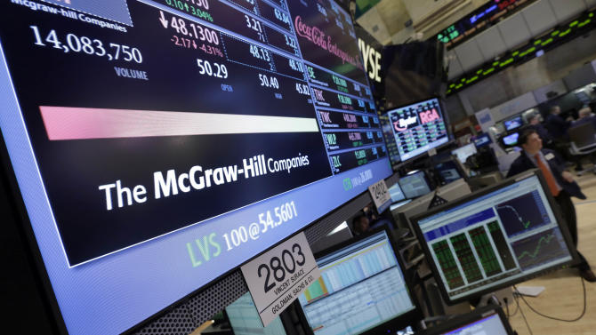 FILE - In this Tuesday, Feb. 5, 2013 file photo, a screen at the trading post for The McGraw-Hill Companies shows its stock price, on the floor of the New York Stock Exchange, in New York. McGraw-Hill reports earnings, Tuesday, Feb. 12, 2013. (AP Photo/Richard Drew, File)