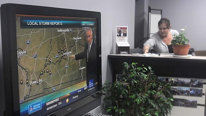 FILE - In this May 2, 2011 file photo, a Weather Channel forecast is broadcast on a television at the Chip Wynn automobile dealership in Paducah, Ky. As part of a redesign that debuted this week, Weather Channel viewers will be able to see their local forecasts on-screen whenever they tune in, even during commercials. The NBC Universal-owned network is also increasing its capacity to cast aside regular programming during severe weather conditions. (AP Photo/The Paducah Sun, John Wright, File)