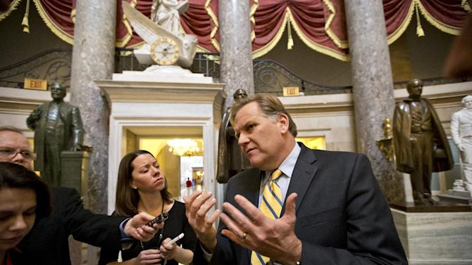 FILE - In this Dec. 31, 2012, file photo, House Intelligence Committee Chairman Mike Rogers, R-Mich., pauses to speak with reporters at the Capitol as Senate and House leaders rush to assemble a last-ditch agreement to head off the automatic tax hikes and spending cuts set to take effect Jan. 1, in Washington. Rogers has pulled off a somewhat rare feat in a bitterly divided Congress: He's created a working, productive relationship with Democrats in overseeing the nation's many spy agencies. The question now is whether Rogers sticks around in the House or fulfills GOP hopes and runs for the U.S. Senate seat from Michigan. (AP Photo/J. Scott Applewhite, File)