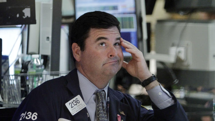 Specialist Stephen Steinthal works at his post on the floor of the New York Stock Exchange Wednesday, Aug. 10, 2011. (AP Photo/Richard Drew)