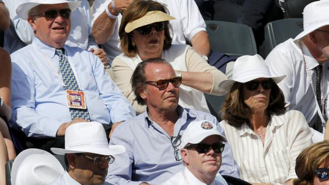 French actor Michel Leeb watches the men's quarter-final match between Novak Djokovic of Serbia and Rafael Nadal of Spain during the French Open tennis tournament in Paris