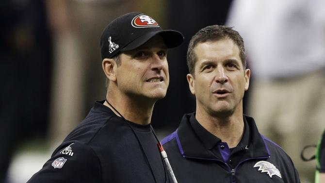 San Francisco 49ers head coach Jim Harbaugh, left, stands with his brother Baltimore Ravens head coach John Harbaugh before the NFL Super Bowl XLVII football game, Sunday, Feb. 3, 2013, in New Orleans. (AP Photo/Gene Puskar)