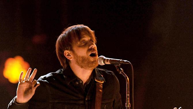 FILE - In a Dec. 10, 2011 file photo, Dan Auerbach, lead singer of The Black Keys, performs at Spike TV's Video Game Awards in Culver City, Calif.  The band's attorney informed a federal judge on Monday, Nov. 26, 2012, that it had settled a lawsuit with Pizza Hut over the alleged misuse of its music in a commercial. The Black Keys reached a settlement with The Home Depot over similar allegations earlier this month, court records show.  (AP Photo/Chris Pizzello, File)