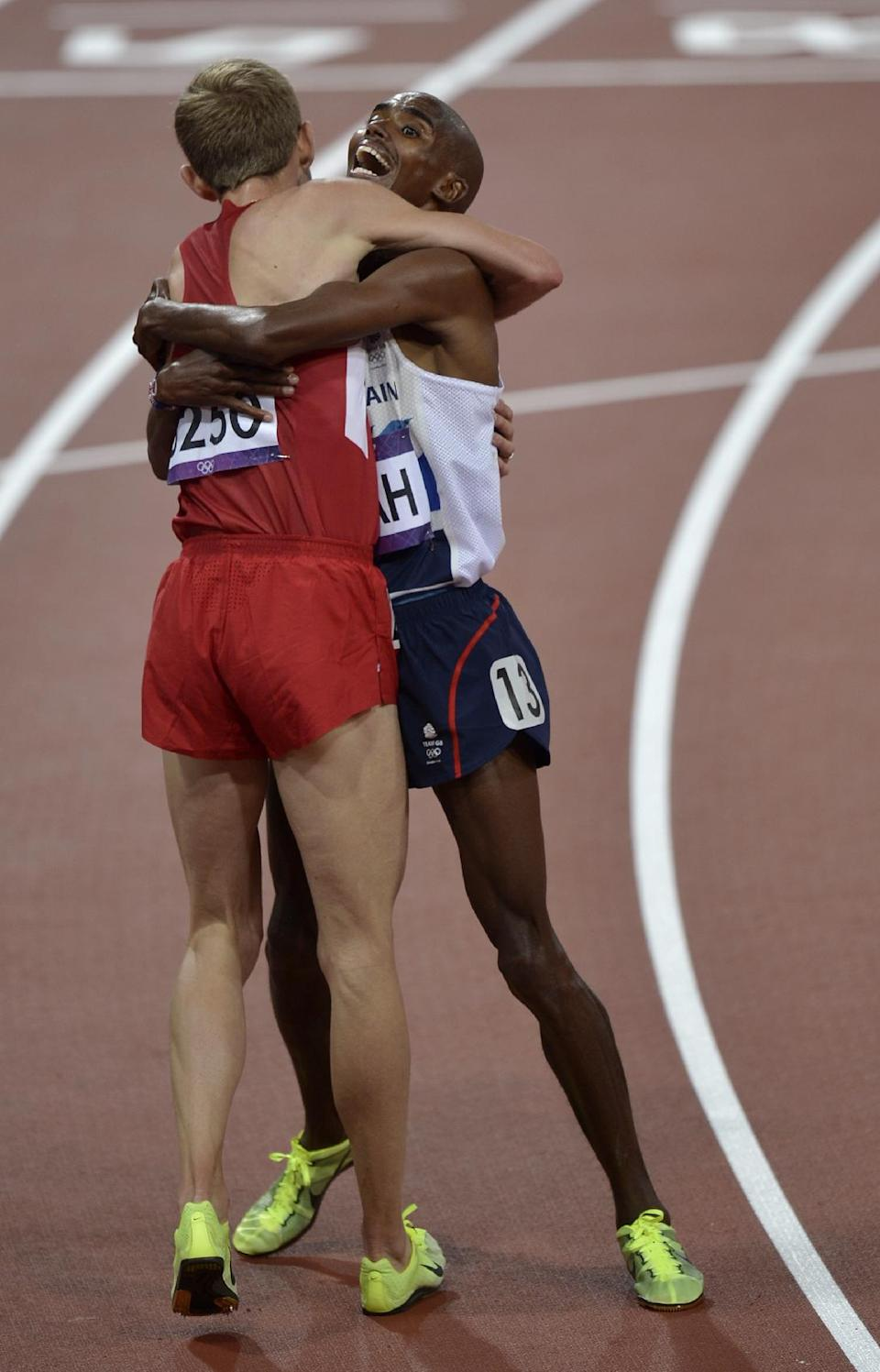 Britain's Mo Farah, right, celebrates winning gold with silver medallist Galen Rupp of the United States following the men's 10,000-meter final during the athletics in the Olympic Stadium at the 2012 Summer Olympics, London, Saturday, Aug. 4, 2012. (AP Photo/Martin Meissner)