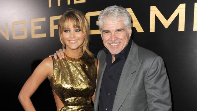 Jennifer Lawrence and director Gary Ross arrive at the premiere 'The Hunger Games' in Los Angeles on March 12, 2012  -- Getty Images