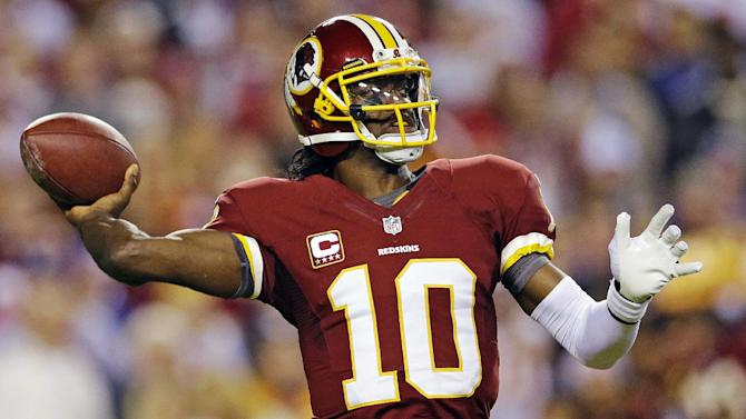 Washington Redskins quarterback Robert Griffin III passes the ball during the first half of an NFL football game against the New York Giants in Landover, Md., Monday, Dec. 3, 2012. (AP Photo/Patrick Semansky)