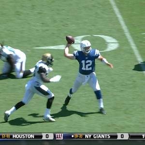 Indianapolis Colts quarterback Andrew Luck escapes pressure and finds wide receiver T.Y. Hilton