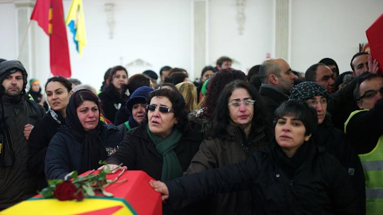 Kurdish people pay tribute to the three activists during a memorial ceremony, in Villiers le Bel, north of Paris, Tuesday, Jan. 15, 2013, before their bodies are sent to Turkey for burial. Three Kurdish women were shot dead at a pro-Kurdish center in Paris on Thursday Jan. 10, in what the French interior minister called an execution. (AP Photo/Thibault Camus)