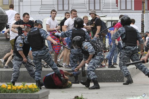 Russian riot police officers clash with CSKA Moscow soccer fans celebrating their team's Russian Premier League Championship title, in Moscow, Russia, Saturday, May 18, 2013,