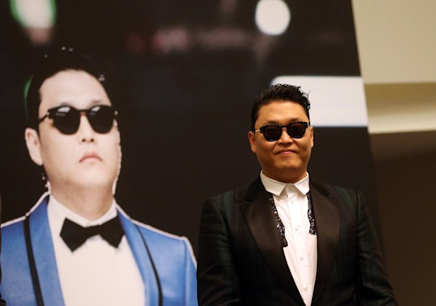 FILE - In this Dec. 1, 2012 file photo, South Korean rapper PSY, who gained popularity from his famous song &quot;Gangnam Style,&quot; gives a press conference prior to his concert at the Marina Bay Sands in Singapore. President Barack Obama still intends to attend a charity concert where PSY is scheduled to perform after reports the South Korean rapper participated in anti-American protests several years ago. (AP Photo/Wong Maye-E, File)