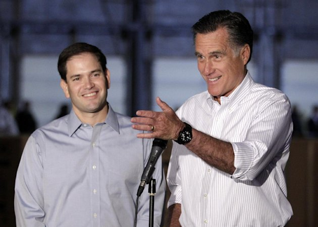 FILE - In htis April 23, 2012, file photo Republican presidential candidate, former Massachusetts Gov. Mitt Romney, campaigning with Sen. Marco Rubio, R-Fla., talks to reporters in Aston, Pa. When Rep