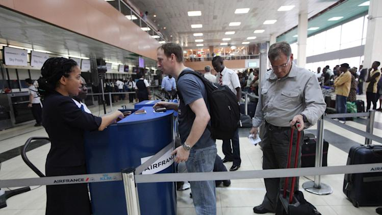 "In this photo taken on Monday, Feb. 4, 2013 passengers lineup to check in for an Air France flight at the Murtala Muhammed International Airport in Lagos, Nigeria. A British national has been kidnapped near Lagos international airport, in Nigeria's commercial capital, the British Consulate-General reported Friday, July 19, 2013. Spokesman Wale Adebayo says diplomats are working with Nigerian authorities on this week's kidnapping. He said he could give no other information because of the ""sensitive nature"" of the issue. (AP Photo/Sunday Alamba)"