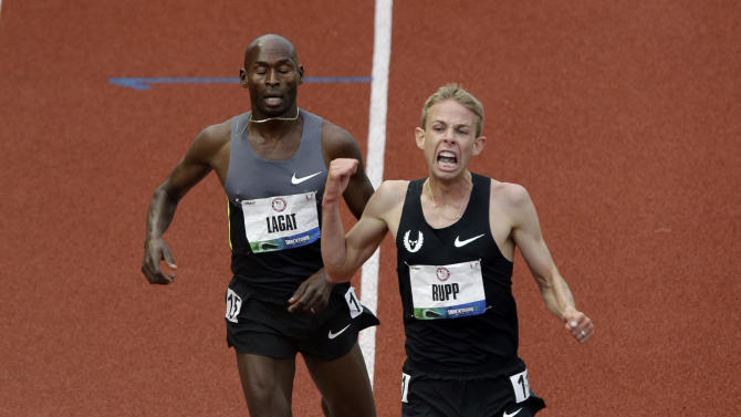 Galen Rupp reacts after crossing the finish line ahead of Bernard Lagat to win the men's 5000 meter final at the U.S. Olympic Track and Field Trials Thursday, June 28, 2012, in Eugene, Ore. (AP Photo/Charlie Riedel)