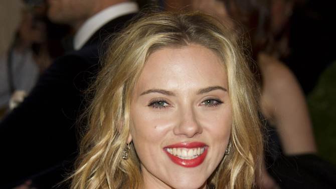 """FILE - This May 7, 2012 file photo shows actress Scarlett Johansson arriving at the Metropolitan Museum of Art Costume Institute gala benefit in New York. Producers on Thursday unveiled the Tony Award-winning Johansson for a revival of Tennessee Williams's """"Cat on a Hot Tin Roof."""" It will be Johansson's first time back since winning a Tony in the Arthur Miller play """"A View from a Bridge"""" opposite Liev Schreiber in 2010. (AP Photo/Charles Sykes, file)"""