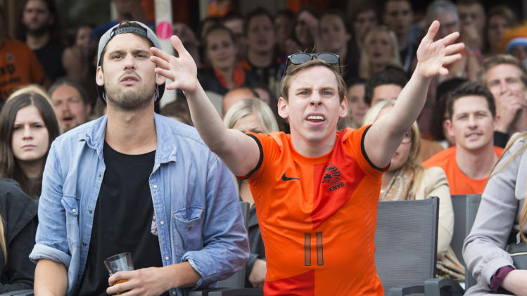 Netherlands soccer fans watch a live broadcast of the round of 16 World Cup match between Netherlands and Chile on a giant screen, in the center of Sittard, Netherlands, Sunday, June 29, 2014. (AP Photo/Ermindo Armino)