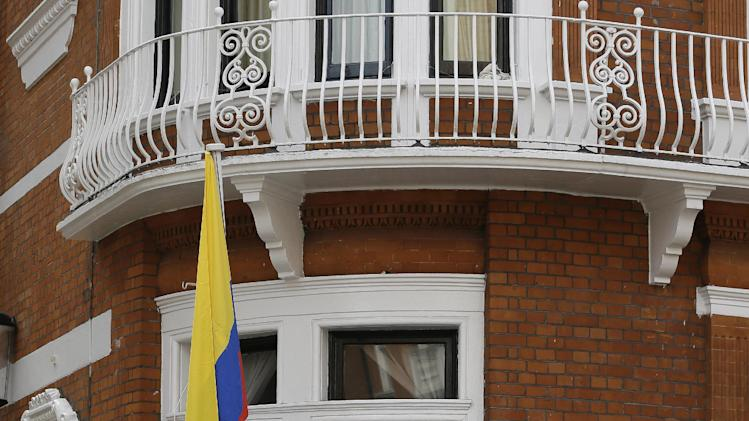 "Julian Assange, founder of WikiLeaks makes a statement from a balcony of the Equador Embassy in London, Sunday, Aug. 19, 2012.  Assange called on United States President Barack Obama to 'end a ""witch hunt"" against the secret-spilling WikiLeaks organization.(AP Photo/Kirsty Wigglesworth)"
