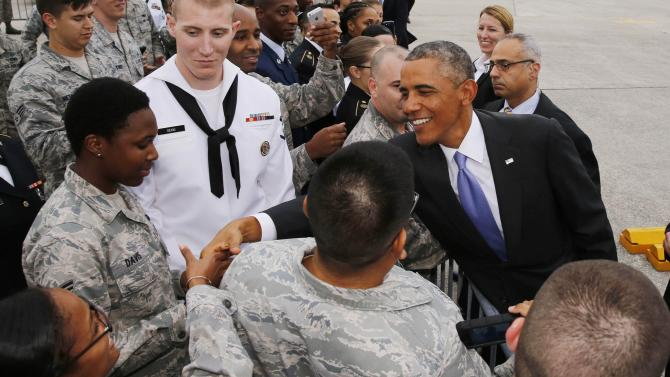 U.S. President Barack Obama shakes hands as he arrives at MacDill Air Force Base in Tampa