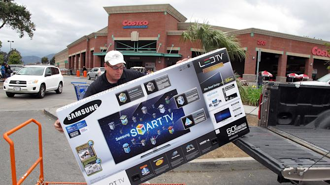In this Feb. 27, 2012 photo, a shopper from Los Angeles, loads a 60 inch Samsung LED TV into his truck at Costco Wholesale store in Glendale, Calif. A private research group says that consumer confidence in February rose to the highest level since a year ago when the U.S. economy's outlook started to look brighter before souring again. (AP Photo/Damian Dovarganes)