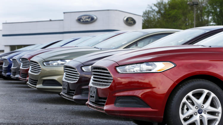 In this Wednesday, May 8, 2013 photo, a row of new 2013 Ford Fusions is seen at an automobile dealership in Zelienople, Pa. Chrysler's U.S. sales rose 11 percent in May, a sign that auto sales rebounded from a slight dip in April and will continue to boost the U.S. economy. (AP Photo/Keith Srakocic)