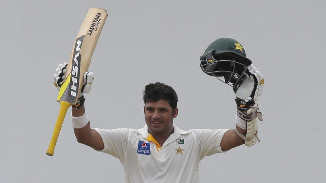 Pakistan's batsman Azhar Ali celebrates scoring a century against Sri Lanka during the fourth day's play of their second test cricket match, in Colombo, Sri Lanka, Sunday, June 28, 2015. (AP Photo/Eranga Jayawardena)