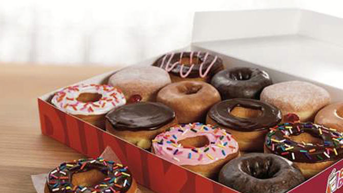 This photo provided by Dunkin' Donuts on Monday, May 5, 2014 shows a selection of the doughnuts they sell. The restaurant chain Dunkin' Donuts is testing whether that deep-fried classic American snack, the doughnut, can compete successfully against entrenched competition from some of the world's most famous sweet snacks in their own homelands, including the waffle in Belgium, apple strudel in Austria and the Danish in Denmark. (AP Photo/Dunkin' Donuts)