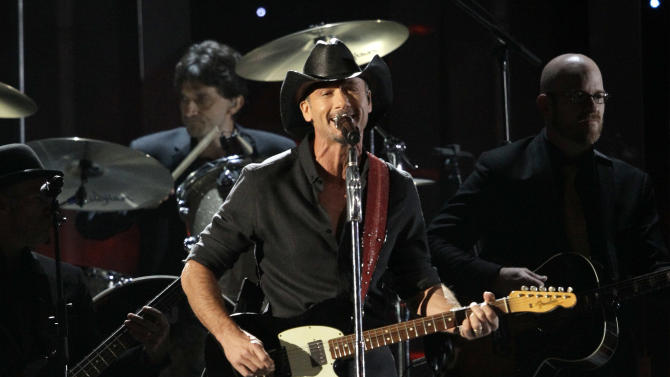"Tim McGraw performs his new song, ""One of Those Nights,"" at the 46th Annual Country Music Awards at the Bridgestone Arena on Thursday, Nov. 1, 2012, in Nashville, Tenn. (Photo by Wade Payne/Invision/AP)"