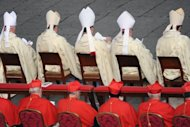Catholic Cardinals attend a 2010 canonisation mass at St Peter&#39;s Square in the Vatican. The Vatican has denied media reports claiming that cardinals tasked with deciding the fate of its bank&#39;s president were struggling to come to an agreement as an internal rift widens