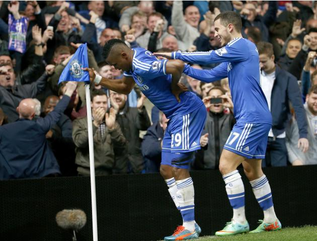 Chelsea's Eto'o celebrates scoring a goal with team mate Hazard during their English Premier League soccer match against Tottenham Hotspur at Stamford Bridge in London