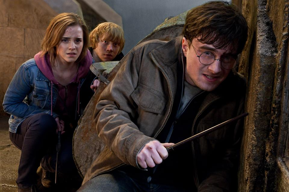 "In this film publicity image released by Warner Bros. Pictures, from left, Emma Watson, Rupert Grint and Daniel Radcliffe are shown in a scene from ""Harry Potter and the Deathly Hallows: Part 2."" (AP Photo/Warner Bros. Pictures, Jaap Buitendijk)"