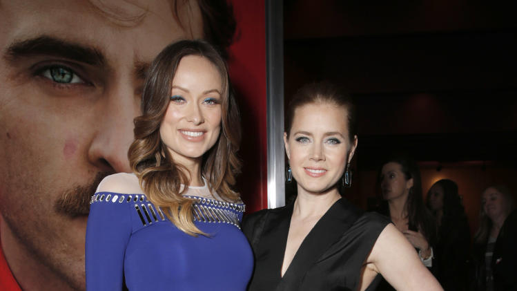 "Olivia Wilde and Amy Adams attend the LA Premiere of ""Her"", on Thursday,December, 12, 2013 in Los Angeles. (Photo by Todd Williamson/Invision/AP)"