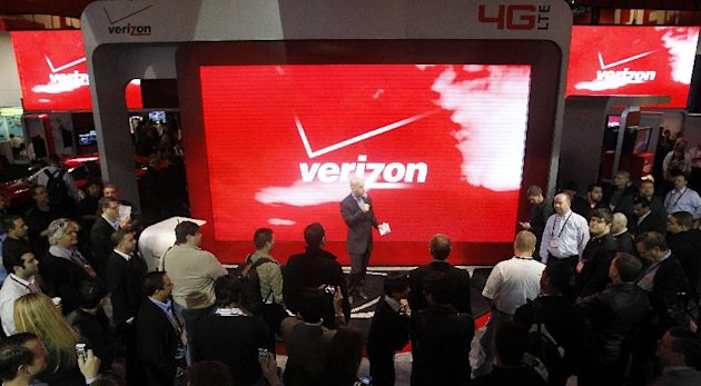 In this Jan. 6, 2012 photo, attendees check out the unveiling of 4G devices at the Verizon booth during the Consumer Electronics Show, in Las Vegas. Challenging Netflix, Verizon said Monday, Feb. 6, 2012, it will start a video streaming service later this year in cooperation with Redbox and its DVD rental kiosks. (AP Photo/Isaac Brekken)
