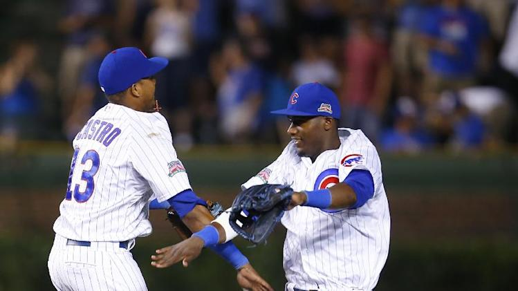 Chicago Cubs shortstop Starlin Castro (13) and left fielder Junior Lake celebrates after their baseball game against the San Diego Padres in Chicago, Tuesday, July 22, 2014. The Cubs won the game 6-0. (AP Photo/Jeff Haynes)