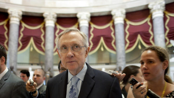 Senate Majority Leader Harry Reid, D-Nev., speaks with reporters as he walks across the Capitol on his way to the office of House Democratic Leader Nancy Pelosi, D-Calif., as national debt crisis negotiations continue on Capitol Hill in Washington on Sunday, July 31, 2011.  (AP Photo/Harry Hamburg)