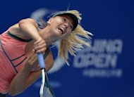 Maria Sharapova serves during her China Open third round match against Polona Hercog of Slovenia. Sharapova defeated Hercog 6-0, 6-2