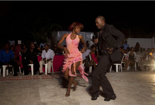 In this Jan. 20, 2013 photo, professional dancer Georges Exantus, right, performs with Modeline Gene Arhan during a show in Port-au-Prince, Haiti. Exantus thought he'd never dance again. The earthquak
