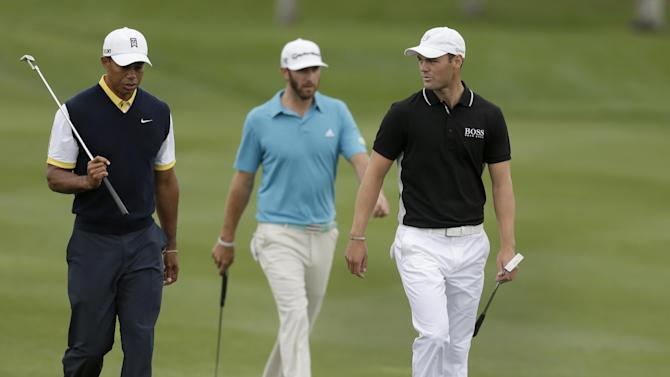 Martin Kaymer, right, of Germany, chats with Tiger Woods, left, as they as the head to the ninth green with Dustin Johnson, center, during the second round of the Honda Classic golf tournament, Friday, March 1, 2013, in Palm Beach Gardens, Fla. (AP Photo/Wilfredo Lee)