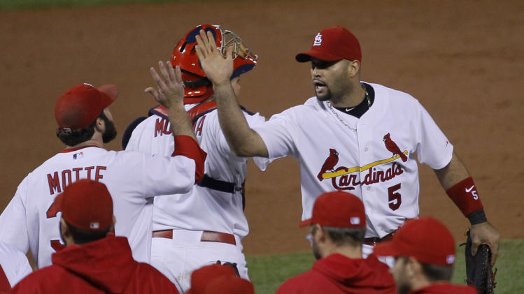 St. Louis Cardinals' Albert Pujols (5) celebrates with Jason Motte after the ninth inning of Game 3 of baseball's National League championship series against the Milwaukee Brewers Wednesday, Oct. 12, 2011, in St. Louis. The Cardinals won 4-3 to take a 2-1 lead in the series. (AP Photo/Charles Rex Arbogast)