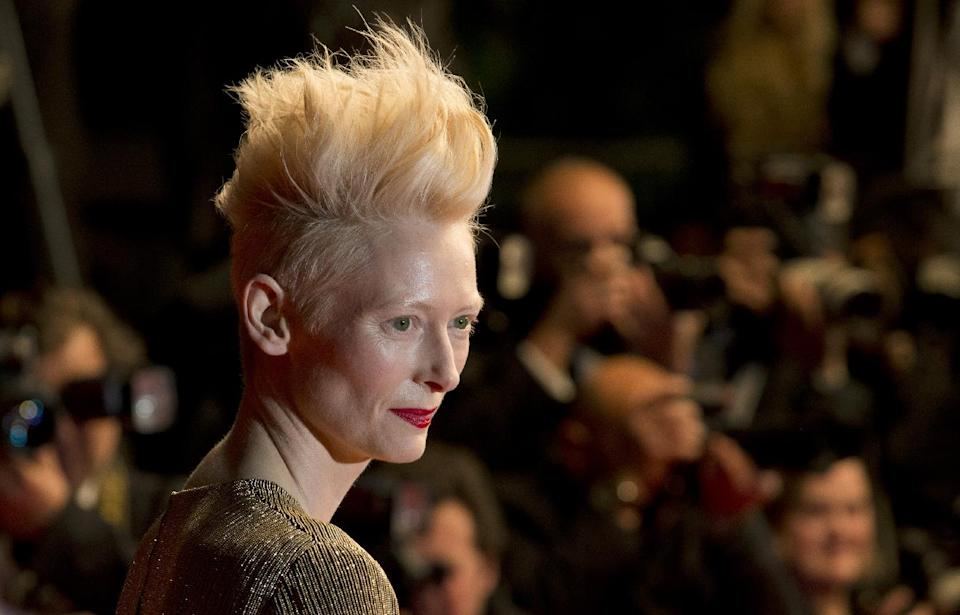 Actress Tilda Swinton poses for photographers as she arrives for the screening of Only Lovers Left Alive at the 66th international film festival, in Cannes, southern France, Saturday, May 25, 2013. (AP Photo/David Azia)