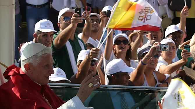 "Pope Benedict XVI, waves to Lebanese faithful from his popemobile on arrival to held mass on the waterfront in downtown Beirut, Lebanon, Sunday Sept. 16, 2012. The Pope celebrated an open-air mass for tens of thousands of pilgrims from across the Middle East, saying Christians must do their part to end the ""grim trail of death and destruction"" in the region. (AP Photo/Hussein Malla)"