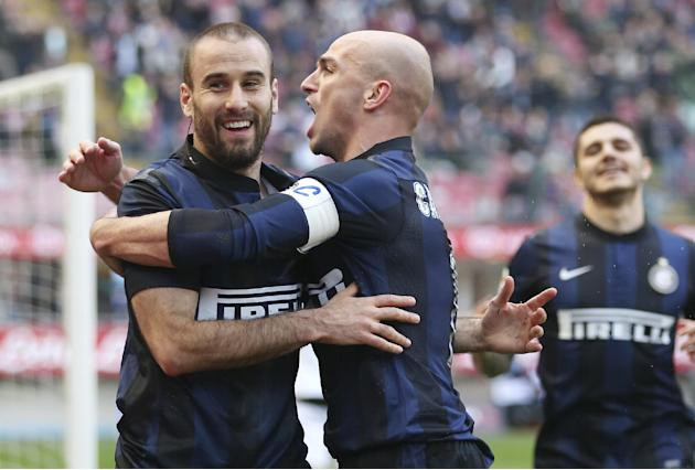 Inter Milan forward Rodrigo Palacio, left, of Argentina, celebrates with his teammate Esteban Cambiasso after scoring during the Serie A soccer match between Inter Milan and Torino at the San Siro sta