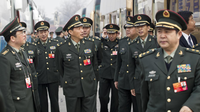 Chinese military officers arrive for a meeting at the Great Hall of the People in Beijing, China, Sunday, March 4, 2012. China says it plans to boost defense spending by 11.2 percent in 2012, as strong economic growth continues to fuel rapid military expansion. (AP Photo/Andy Wong)