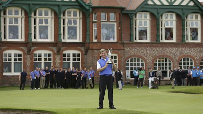 Ernie Els of South Africa holds the Claret Jug trophy after winning the British Open Golf Championship at Royal Lytham & St Annes golf club, Lytham St Annes, England Sunday, July  22, 2012. (AP Photo/Jon Super)