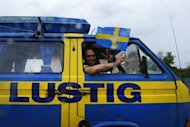 "Swedish fans from ""Camp Lustig"" drive to ""Camp Sweden"" in Kiev during the Euro 2012. Swedish football fans are prepared to live in near-primitive conditions so as to get a chance of seeing the Swedish team in action"