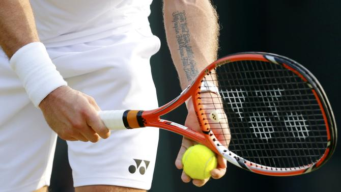 Stan Wawrinka of Switzerland prepares to serve during his match against Victor Estrella Burgos of Dominican Republic at the Wimbledon Tennis Championships in London